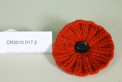 Knitted Anzac commemorative poppy; Unknown maker; c. 2015; CR2015.017.2