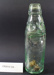 Bottle, tinted glass from Lanes Ltd Dunedin.; Unknown; Unknown; CR2012.104