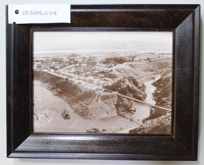 Aerial photograph, Cromwell c.1900, dredge and bridge in foreground.; Unknown; Unkown; CR2003.028