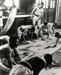 """Photograph of Boys scrubbing their white duck suits on a """"dhobey day"""" in 1937; SHHMG:A4106"""