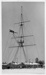 Photograph of the Mast at Shotley flying White Ensign; photographer : unknown; SHHMG:A580