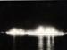 3 photographs of HMS London and HMS Gambia illuminated.; SHHMG:A3011