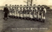 11 boys in heavy marching gear with an Instructor.; SHHMG:A2084