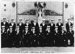 Photograph of 5 class Grenville Division June 1951 taken in Nelson Hall. 19 boys dressed in best blue uniform, some with lanyards and some with call chains indicating that they are seaman branch.; SHHMG:A436