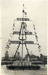 Postcard of the mast, manned and dressed.; photographer : Fisk, R A, Mr; SHHMG:A1367