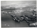 A  photograph of the North yard of Devonport Dockyard. Captain Norman Henry Pond was a boy at HMS Ganges in 1926, was rated up to Warrant Officer in 1939. As a Commander he was awarded the American Legion of Merit medal for his work in the Korean War. He left the Royal Navy as a Captain in May 1964, his last appointment was as Captain of Devonport Dockyard. ; SHHMG:A10683.1