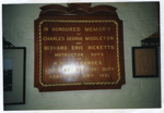 colour photograph of memorial board to the memory of Charles George Middleton and Bernard Eric Ricketts, Instructor boys lost at sea, off Felixstowe, on board MTB 5518 during night exercise on 26th February 1951. Actual board on display in the Museum.; SHHMG:A439