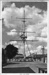 Picture of mast at HMS Ganges with boys on rigging and one boy sitting on button (at the very top); SHHMG:A524
