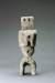 Carved wooden totem with arms and legs and round holes for eyes and belly button; Unknown; DCR-2017-024