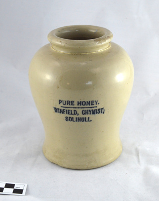 Glazed Earthenware Jar with Printed Label: Honey; Winfield Chemyst, Solihull; Circa 1880s; H2014.001