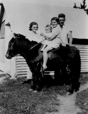 Photo, Ollie and Chris Ordish with their two children on a horse; 2005/224.79