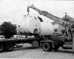 Photo - Removing the vats before the closure of the Eumundi Butter Factory in 1972; 1972-1972; P-1297-0