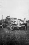 Photo - Andrew Mergard and truck, c.1948; 1948-1948; P-643-0