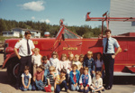 Class photo in front of a firetruck with two firemen; FNPL2016.011.073