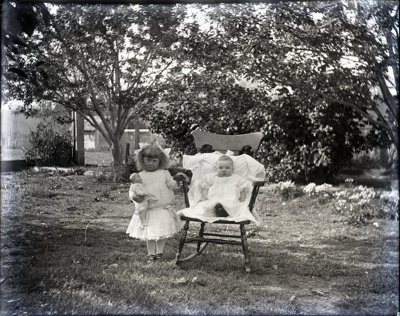 Young children posed outdoors in chairs; Aitken, John; 2017.1.092