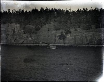Aitken boat Dorothea with cabin added near rocky shore; Aitken, John; 2017.1.057