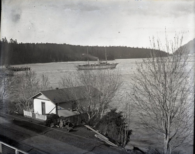 Patrol vessel Shearwater seen over house built by John Aitken with Miners Bay dock on left; Aitken, John; 2017.1.030