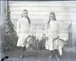 Aitken daughters Dorothy and Ellen posed in front of a house; Aitken, John; 2017.1.079