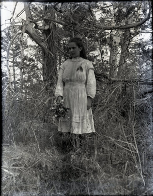 Photograph - Girl against forest backdrop.; Aitken, John; 2017.1.313