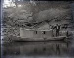 Old wooden boat by a rocky cliff; Aitken, John; 2017.1.039