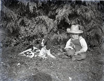 Photograph - Aitken son with dog.; Aitken, John; 2017.1.325