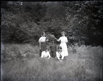 Four women and a girl posed in a field; Aitken, John; 2017.1.069