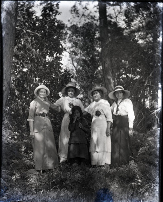 Photograph -  Four women standing outside posed against forest backdrop.; Aitken, John; 2017.1.299