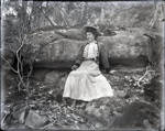Woman seated on a rock wearing a balmoral jacket; Aitken, John; 2017.1.055