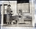 Aitken daughters with pet fawn in front of Mayne Store; Aitken, John; 2017.1.080
