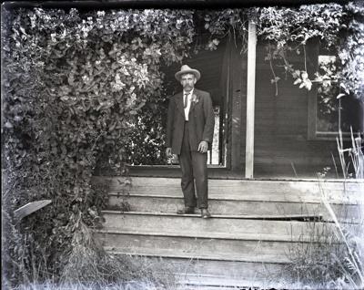 Photograph -  Man in suit on stairs outdoors.; Aitken, John; 2017.1.306