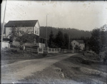 Photograph - Aitken Miner's Bay Store showing fence and Mayne Island Hotel in background.; Aitken, John; 2017.1.255