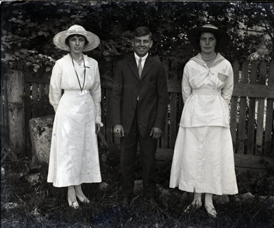 Photograph -  Three people posed outdoors with picket fence behind.; Aitken, John; 2017.1.304