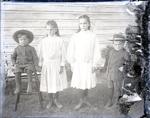 Aitken kids: Ellen, Dorothy, Roy and John, posed in front of a house; Aitken, John; 2017.1.078
