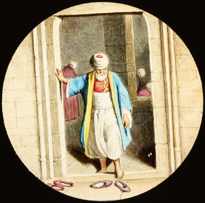 Lantern Slide - Arabic Man Putting Shoes On; 1850-1910; MV.MM.112739
