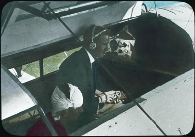 Dr. Vickers sending a message using the communications apparatus in an aeroplane of the Flying Doctor Service, ca. 1932 / Rev. Andrew Barber; Barber, J. Andrew; 1931; HL.NL.23945336