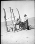 [A woman with two men, seated on a wooden structure] scenes in the Diamantina area and other general scenes / [John Flynn?]; Flynn, John, 1880-1951; 1912-1951; HL.NL.23085461