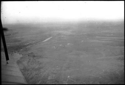 Aerial view of unidentified landscape : general Australian Inland Mission scenes / [John Flynn?]; Harringtons Ltd; Flynn, John, 1880-1951; 1929; HL.NL.23938008