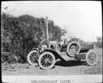 """""""Dreadnought Lizzie""""- early car with a driver and a dog : inland people and general scenes / [John Flynn?]; Flynn, John, 1880-1951; 1912; HL.NL.17367569"""