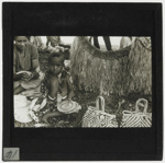 Lantern Slide - Child Sitting Amongst Handcrafts, Pacific Islands, circa 1930s; MV.MM.113739