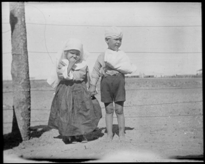 [A girl and boy in costume] scenes in the Diamantina area and other general scenes / [John Flynn?]; Flynn, John, 1880-1951; 1912-1951; HL.NL.22987305
