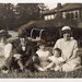 Photograph of a family outside the Refreshment Chalet, Wanstead Park; ARN0147