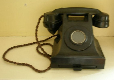 Telephone with braided cord; Item