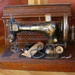Sewing machine; Treadle, portable enclosed in wooden casebox; ART-0085