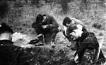 photo negative - examining unexploded bombs; 1940; 2018.1.372