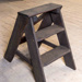 Wooden step ladder. Heavily oil soaked. Originally light coloured timber.  ; Unknown Maker; 2019.4
