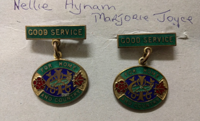 Country Women's InstituteGood Service badges (x2) Owners: HYNAM, NellieJOYCE, Marjorie; CCWI.001.79
