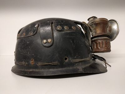 Early miners' carbide lamp attached to miner helmet ; 1900; GCM.001.008