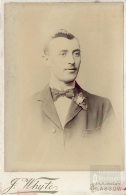 Young man with buttonhole and bowtie; ULMPH 2000 0560