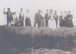 Group of people on top of Hay stack; 1900?; ULMPH 2000 0580