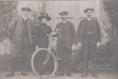 3 young men and a young woman plus bike outside house -; 1914?; ULMPH 2000 0550